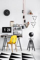 Globe on black stool