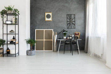 Simple workspace on gray wall
