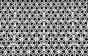 Detail of a mosque wall; decorative geometric pattern inspired by Islam related symbols
