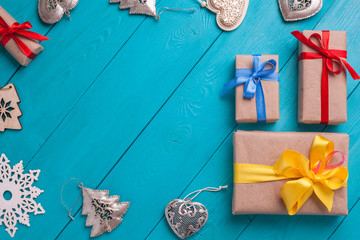 Turquoise background for Christmas cards. Background for Christmas wishes. Blue wooden planks. Vintage background for congratulation. Christmas card. Christmas gifts. Holiday gift. Christmas deer.