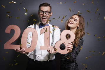 Portrait of couple with new year's number