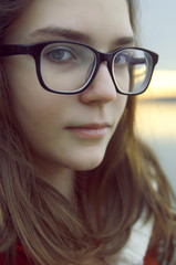 Portrait of young girl with glasses,close up