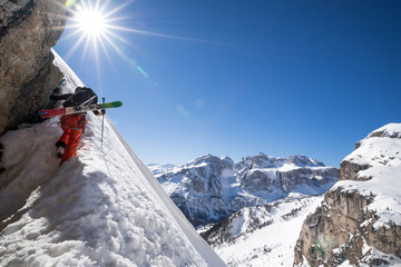 A skier is climbing a mountain of the Dolomites in Northeastern Italy.