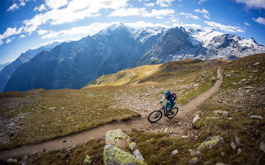 A mountain biker does off-road racing at the Ortler region in Italy.