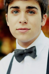 A young man wearing a bowtie