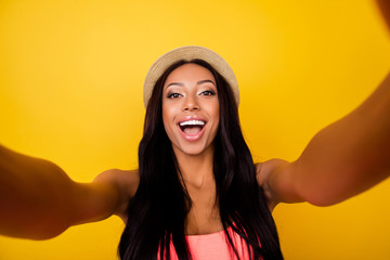 Relax, dream, chill mode! Girlish gorgeous carefree dreamy traveller in trendy beige head wear with wide open mouth, so hot, taking selfie shot, makes memories at holiday and for her blog, shouting