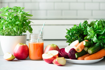 Fresh juice or smoothie, fruits and vegetable - apples, carrot, beet, celery, cucumber, greens, herbs. Vegetarian, raw food concept, clean eating, detox