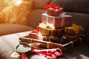 Christmas lifestyle concept. Christmas gifts and decoration in the room.