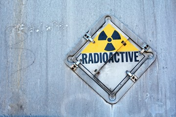 Radioactive sign on rusty grungy background