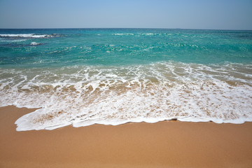 the waves of the Indian Ocean on a beautiful sand