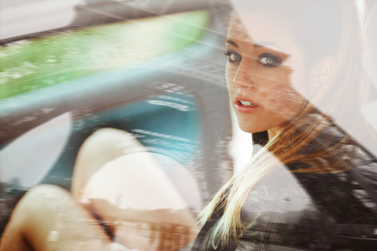 Business woman in a car in france