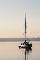 Sailboat on calm waters at dawn
