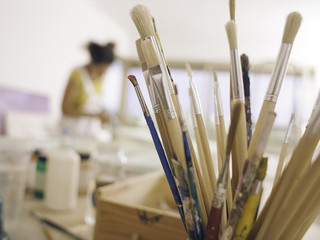 Pot with brushes. Detail of artist studio.