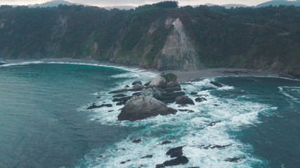 view from a height to rocks and waves