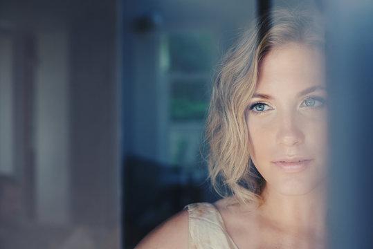 Beautiful Woman gazing out of window
