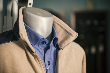 sweater and shirt on a mannequin