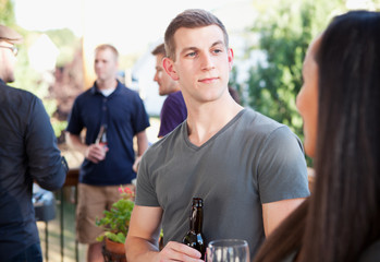Party: Man Listening To Woman During Party