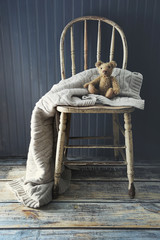 Little teddy bear on old country chair