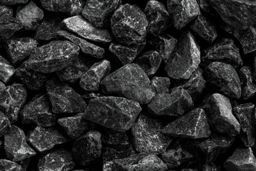 Closeup shot of black natural charcoal texture background,