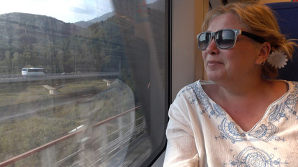 A woman travelling by train .
