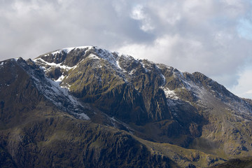 The snow covered summit of Pillar on a sunny winters day in the English Lake District.