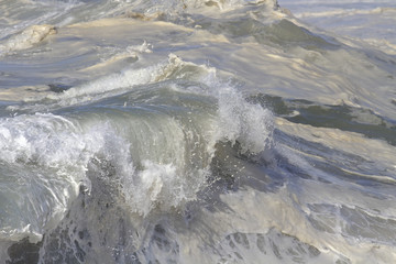 Detailed top of a breaking wave