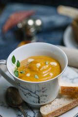 Teacup of pumpkin soup.