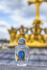 Holy water in a beautiful small bottle. Lourdes, France