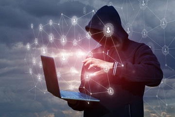 Hacker delves into the network through a laptop .