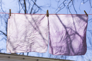 Natural dyed linen hanging to dry