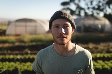 Portrait of farmer standing on farm