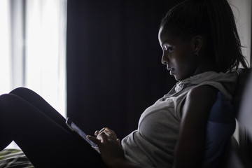 Young Woman Looking at Tablet Computer