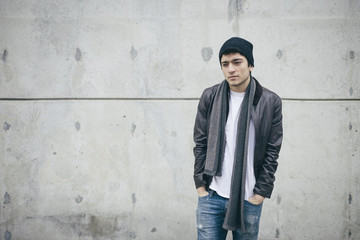 Portrait of Mexican-American Young Man in Leather Jacket and Jeans