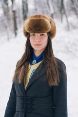 Portrait of a beautiful girl wearing winter hat