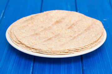 pita on white plate on wooden background