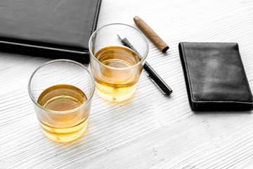 Relax for men. Whiskey in the evening. Glasses, wallet, cigar on grey background top view
