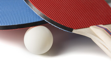 Red and Blue Ping Pong Paddles - Closeup On White