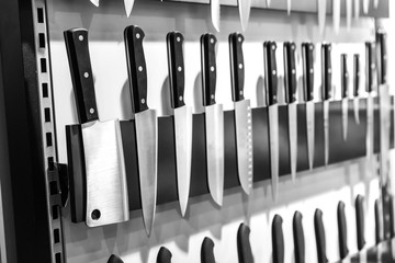 Kitchen knives on magnetic holder closeup