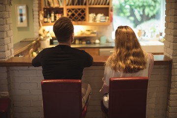 Couple having coffee together in the kitchen