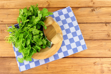 Bunch of fresh coriander on a wooden herb chopping board
