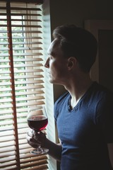 Thoughtful man having red wine