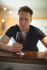 Thoughtful man having red wine