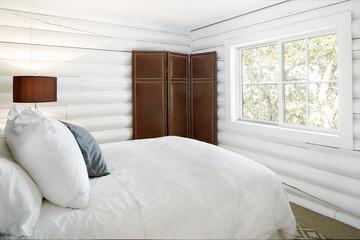 Bedroom in modern design log cabin