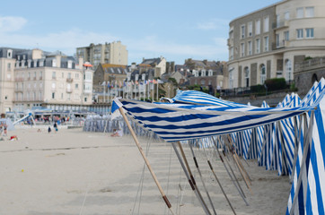 Traditional striped beach tents on Dinard beach in Brittany, France