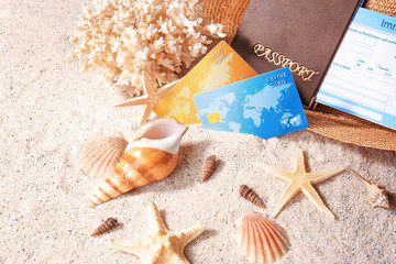 Credit cards and shells on sand