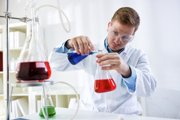 Young scientist research chemistry test in laboratory