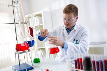 Health care professional chemist working in laboratory