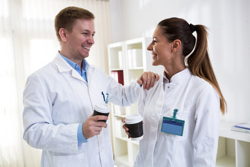 Scientists talking and holding coffee