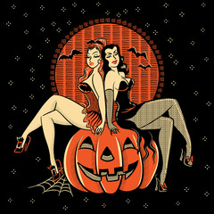 Spooky Halloween glamour twins sitting on a carved pumpkin head.
