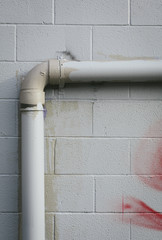 Detail of drain pipe and building wall